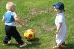 Babies playing soccer.