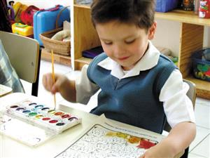 Child doing watercolor